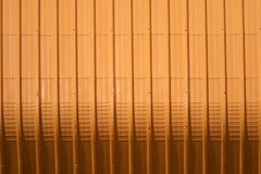 Orange metal sheet pattern and vertical line design. Metal sheet pattern and vertical line design on surface abstract aluminum architecture background blank royalty free stock photography
