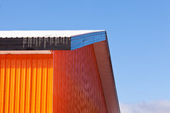 Orange metal sheet siding warehouse construction Stock Photo