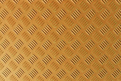 Orange metal textured floor surface. Royalty Free Stock Photo