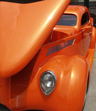 Orange Metallic Hot Rod. Interesting texture created by grill and shape created by angle of hood. Car fills the frame. Used natural light stock images