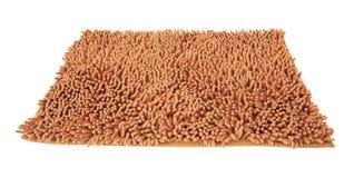 Orange Microfiber mattt som isoleras på vit Royaltyfri Foto