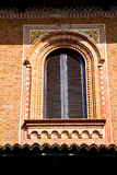 orange        in  the milano old   window closed brick    abstra Royalty Free Stock Photo