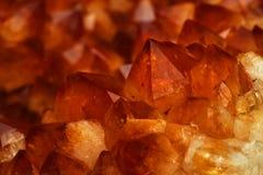 Mineral Citrine quartz cluster crystal texture. Orange mineral Citrine quartz cluster crystal texture stock images