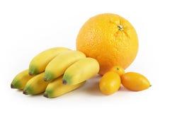 Orange mini banana kumquat. Group of fruits, orange mini banana and kumquats Stock Photos