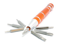 Orange miniature screwdriver. With interchangeable nozzles on a white background Stock Images