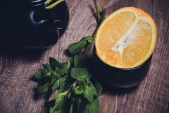 Orange and mint tea served in cup Stock Images