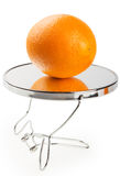 Orange on a mirror    Stock Photography