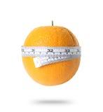 Orange mit dem Messen stockfoto