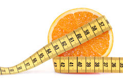 Orange mit messendem Band Stockfotos