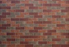 Orange mixed color brick wall background. Orange mixed color brick wall texture Stock Images