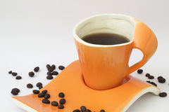 Orange modern cup and coffee Royalty Free Stock Images