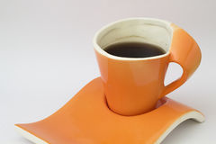 Orange modern cup and coffee Stock Image