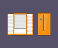 Orange modern household appliances fridge with two doors isolated on dark blue background. Electronic device Royalty Free Stock Photography