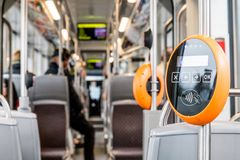 Public transportation wipe ticket validator. Orange modern magnetic ticket validator stock photos