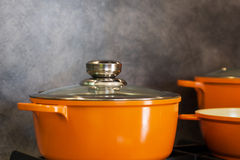 Orange modern pots in the kitchen Royalty Free Stock Images