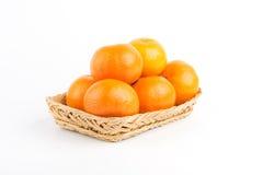Orange moget i korg Royaltyfri Foto