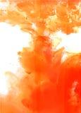 Orange moln av färgpulver Arkivbilder