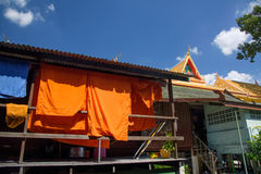 Orange monk clothes drying Royalty Free Stock Images