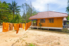 Orange monk clothes drying on the sun Stock Image