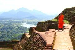 Orange Monk. Monk from Sri Lanka on Sigiriya Rock Royalty Free Stock Images
