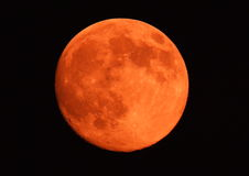 Orange moon. As it rises above the horizon in Greece Stock Image
