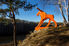 Orange moose. On the river Bank in Russia in the Urals Stock Images