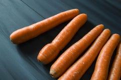 Orange morötter i olika format, precis morotbilder Arkivbild