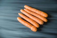 Orange morötter i olika format, precis morotbilder Arkivfoton