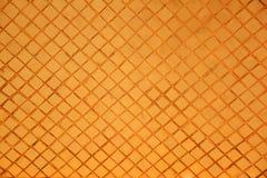 Orange mosaic wall pattern background. Stock Images