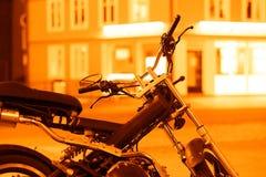 Orange moto bike in Tromso background Royalty Free Stock Photography