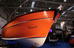 Orange motor yacht. An orange motor yacht at the the The Big Blu - 7TH EDITION FOR THE BOAT AND SEA EXPO OF ROME  in Rome, Italy for the dates of February 20 Royalty Free Stock Photo