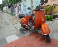 Orange motorcycle stop at lane with graffiti painting on colourful and creative art Stock Images