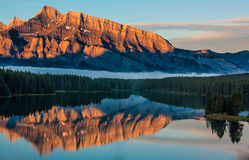 Orange Mountain Reflection in Lake Minnewanka Royalty Free Stock Photo