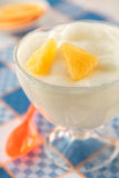 Orange mousse in a glass on checkered napkin Stock Photography