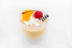 Orange Mousse with red cheery in glass Stock Photo