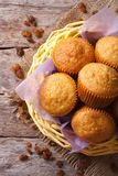 Orange muffins in a basket and raisins top view vertical Royalty Free Stock Image