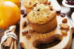 Orange muffins with dried fruits Royalty Free Stock Photo