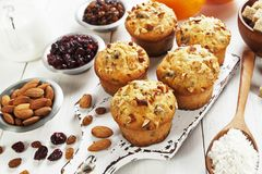 Orange muffins with dried fruits Royalty Free Stock Photos