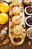 Orange muffins with dried fruits Stock Images