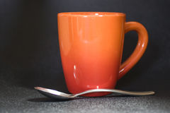 Orange mug Royalty Free Stock Image