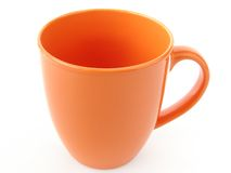 Orange mug Stock Photos