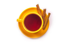 Orange mug with cinnamon royalty free stock photography