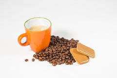 Orange mug with coffee beans and cookies 01 Stock Image