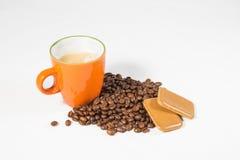 Orange mug with coffee beans and cookies 01. Orange mug with coffee beans and cookies stock image