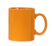 Orange mug Stock Images