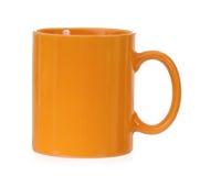 Orange mug. For coffee or tea, isolated on white background Stock Images