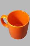 Orange mug one Stock Photos