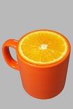 Orange mug and orange Royalty Free Stock Photo
