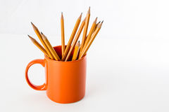 Orange mug with pencils Royalty Free Stock Image