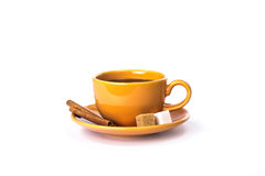 Orange mug with sugar and cinnamon stock image